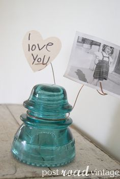 turquoise insulators as photo holders! on window sill?  We need to make these EM!  @Emily Charnelle