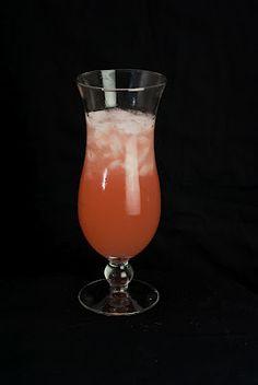 Sunburnt Breeze     (1 1/2 shots vanilla vodka  3/4 shot Malibu Rum  2 shots pineapple juice  1 shot cranberry juice   1/4 shot grenadine)