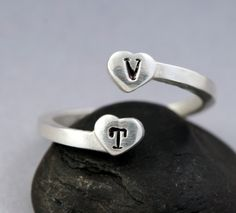 I want this so very badly.  Personalized Ring - SILVER initial ring - slightly adjustable small personalized hearts ring. $38.00, via Etsy.