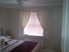 Cream Bedroom Curtains And Vertical Blinds