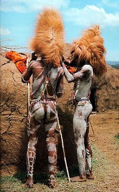Maasi warriors wearing hats made of the main of a lion that they each have killed. When the warrior becomes a junior elder, he must throw away the lion mane through a sacrificial ceremony to ward off spirits.