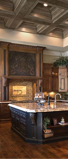 Gorgeous tuscan kitchen with high soffit ceiling, and ornate hood.