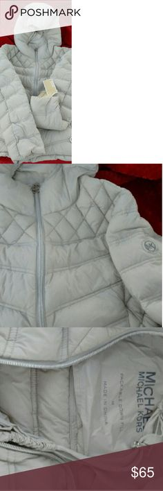 """Michael Kors Packable Down Puffer Hooded Coat Lightweight, yet totally warm, this MICHAEL Michael Kors puffer is the ultimate coat for chilly days out. The matching """"pack-sack"""" is perfect for an on-the-go lifestyle. Rare Light silver gray in color with silver hardware. Allover quilted nylon with down and feathers fill Front zipper closure Attached hood Lightweight-feel jacket with super warmth Zip side slant pockets Smocked at mid-back Includes coordinating packable, cinchable sack Michael…"""