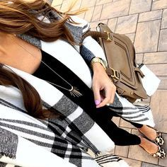 Love the black and white with animal print and neutral bag.