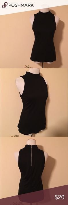 Sexy WHBM Zip Up Sleeveless Black Turtleneck Sz M The sleeveless turtleneck from White House Black market is very sexy! Made of a black velvety material it is supersoft. Great for a night out! Or you can dress it down and wear it to the office. Size medium. Barely worn, no signs of wear. Brand-new condition! White House Black Market Tops