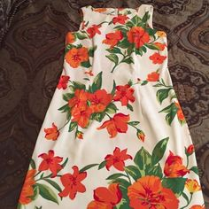 Kim Rogers sleeveless dress 10 Beautiful floral with orange,green on ivory background. Worn once! Size 10 women. 97% poly, 3% spandex. Looks great with tan!! 35 inches long from shoulder to hem. Kim Rogers Dresses