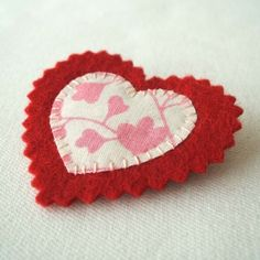 Upcycled Fabric Heart Brooch Tutorial   •  Free tutorial with pictures on how to make a fabric brooch in 8 steps