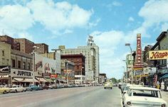 """washington ave, lansing mi..1960. This was """"downtown"""" for me as a kid.  I remember going to the Gladmer and the Michigan theaters with my dad & friends.  The dime stores, Liebermann's for leather goods, the Peanut Shop....fun times!"""