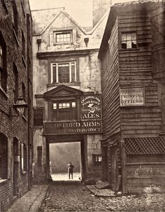 At the entrance to the Oxford Arms  the Society for Photographing the Relics of Old London was set up to save the Oxford Arms, yet it failed in the endeavour, preserving only this photographic record.>> One of a collection of wonderful early photographs of the Capital.