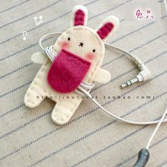 who takes care of your headphone wire? this little bunny does. so helpful, little bunny