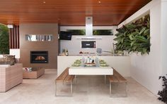 open-space-decor-with-kitchen-countertop-extension - Home Decorating Trends - Homedit Table With Bench Seat, Kitchen Table Bench, Dining Room Bench, Dining Table, Dining Rooms, Dining Area, Modern Outdoor Kitchen, Build Outdoor Kitchen, Outdoor Dining