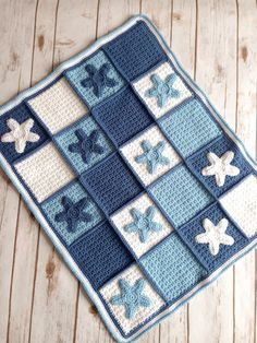 Crochet baby blanket made to order with beautiful star appliqué detail. Available in several sizes this lovely blanket is perfect from little baby up to toddler and beyond. Hand crocheted in snuggly baby soft Aran yarn, this is a blanket your little one will want to keep and love. This would make a wonderful baby shower gift too!  Giving as a gift? Why not make it extra special and add gift wrapping and a personal message to your order?; https://www.etsy.com/uk/listing&#x2...