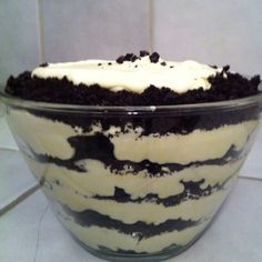 1 bag Oreos (crushed), 8 oz cream cheese (softened), 1/4 cup butter, 1 cup powdered sugar, 3 cups milk, 2 sm boxes instant vanilla pudding, 1/2 tsp vanilla, 12 oz Cool Whip (thawed). Cream together cream cheese, butter & powered sugar & vanilla. In separate bowl mix milk & pudding. Chill until set. Fold in cool whip after pudding has set. Add cream cheese mixture. Layer with Oreos.