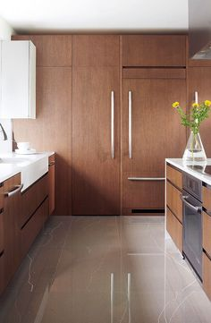 Kitchen with gray ceramic floor, wooden cabinet and covered refrigerator as the cabinets rnrnSource by Wooden Cabinets, Kitchen Cabinets, Exterior Design, Interior And Exterior, Cuisines Design, Kitchen Flooring, Kitchen Remodel, Tile Floor, Kitchens