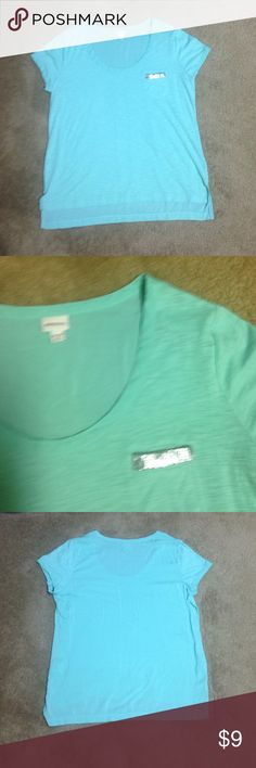Merona teal t-shirt Merona teal t-shirt with silver embellished lined pocket.  Never worn but no tag.  Cotton and polyester blend front and rayon back.   Scoop neck.  Machine washable. Second and fourth pics are the true color of shirt. Merona Tops Tees - Short Sleeve