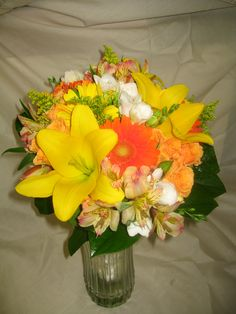 I'm not a huge fan of the orange, but I love that this boquet includes just a few, but not too many lilies.