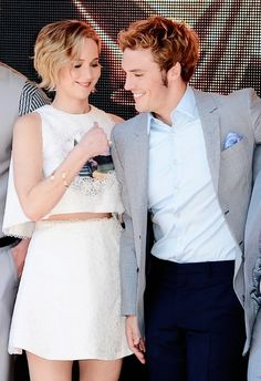 Jennifer Lawrence and Sam Claflin attend 'The Hunger Games: Mockingjay Part 1' photocall at the 67th Annual Cannes Film Festival