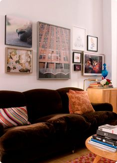 A lovely salon-style wall of 20x200 art above a sofa in founder @Jen Bekman's apartment.
