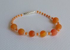 Orange Fire Agate and Seed Beads with Silver Plated Bead on a