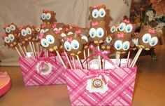"""Owl Cake Pops - These owl cake pops were made to match the cake with """"Look Whoo's turning 1"""" theme provided by the mom for the sweet birthday girl.  I made all fondant decorations (eyes, feet, bow)  I thought they came out cute :)"""