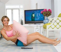 Workout while watching TV. Get in shape without missing your favorite shows. The Torso Twist will whittle your waist. Sit on floor with legs extended and knees bent. Hold a pillow with both hands at chest level and lean back at a 45-degree angle. Maintain this position as you contract your abs and twist torso right and then left to complete one rep. Repeat. #SelfMagazine