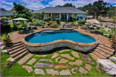 Swiming Pools Above Ground Pool Deck With Green Outdoor Umbrellas Also Stainless Outdoor Chair And Metal Patio Table Besides Outdoor Flooring Tile  Landscaping Design  Patio Accessories Furniture  Garde Design   Above Ground Pool Deck Ideas