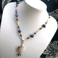 MOP Bronze and Blue Necklace by artemis17 on Etsy, $26.00  Love the color combo!