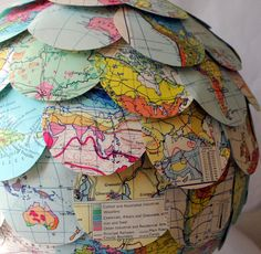 paper lantern lamp shade created from a vintage world atlas