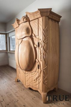 Insect-Inspired Armoire Brings the Beauty of Nature Indoors. not sure I would want one, but love it.