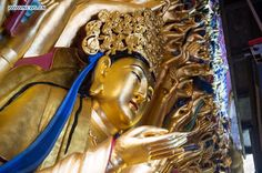 Photo taken on May 5, 2015 shows the restored statue of Qianshou Guanyin (bodhisattva with a thousand hands) on Mount Baoding in Dazu District, Chongqing. http://www.chinatraveltourismnews.com/2015/05/restored-buddha-statue-to-reopen-to.html