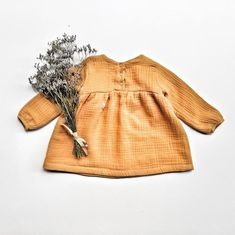 A tunic? In double layered super soft muslin fabric and in 3 heartwarming colors, this one is just the perfect balance of sweetness and style. Slow Fashion, Kids Fashion, Unique Baby Clothes, Kids Boutique, Ruffle Shirt, Warm Grey, Winter Collection, Anchor, Fall Winter