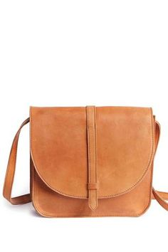 Handcrafted in Ethiopia, the Tirhas by FashionAble is a classic leather saddlebag that can be worn both cross-body or on one shoulder. 100% Ethiopian distressed leather.
