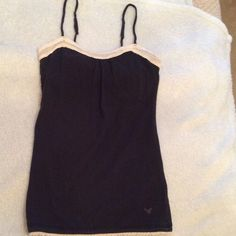 SPRING SUPER SALE  AE Tank Top Super Cute. Black tank with lace at the neckline and the waistline. Has a built in bra shelf and adjustable straps. Is in Great Condition. American Eagle Outfitters Tops Tank Tops