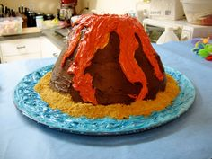 Volcano Cake- I wanna make one of these with Kase bc he love volcanoes & dinosaurs!!!