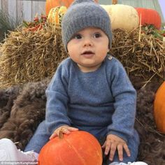 Prince Oscar of Sweden, seven months, has been pictured sitting up for the first time on a visit to a pumpkin patch at the Solliden and Öland harvest festival