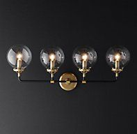 RH Modern's Bistro Globe Bath Sconce 4-Light:Inspired by 1940s industrialism, our globe sconce's lines and spheres are reminiscent of an urban subway map.SHOP THE ENTIRE COLLECTION ▸