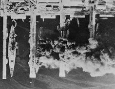 French ships Strasbourg, Colbert, Algérie, and Marseillaise burning in Toulon harbor, France, 28 Nov 1942; photo taken by a RAF aircraft-13 Nov 1942-Adolf Hitler promised France that Germany would leave the French fleet at Toulon, France alone. 25 Nov 1942 Adolf Hitler ordered the seizure of the French fleet at Toulon, France.- 27 Nov 1942 Germans occupied naval base at Toulon; -French Navy scuttled warships to avoid German capture.