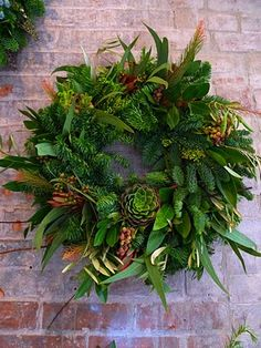 denise fasanello's laurel wreaths with succulents you can keep for after the holidays. genius.