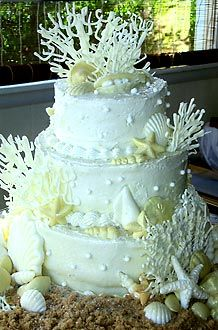 beach wedding cake with coral and shells ecorations created by Liz bushong | Taste of Home Recipes
