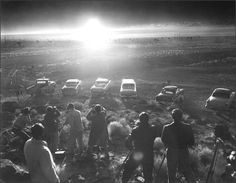 Photographers and reporters gather near Frenchman Flat to observe the Priscilla nuclear test