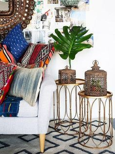 Love this gorgeous mix of vintage indigo mudcloth pillows and kilim textiles with the iron Moroccan lanterns on the gold side tables. Studio Tour: Justina Blakeney's Boho Space - See the full tour on our Style Guide!: