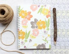 """This spiral bound notebook features Caren's hand-drawn design """"Spring Blossom"""", inspired by visits to Cambridge Botanic Gardens and Spring walks through her village. This floral notebook is part of Caren's recent crowd funded project with . A5 Notebook, Jute Twine, Spring Blossom, Spiral, Card Stock, How To Draw Hands, Colours, Journal, Antiques"""