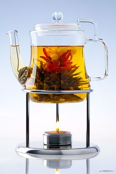 Provide jasmine and a second, seasonal flavored blooming tea in glass ware. Also use for floral/herbal teas? Etch tearoom logo on one side if each glass pot? Glass Teapot, Cuppa Tea, Liqueur, Flower Tea, Tea Art, My Cup Of Tea, Tea Accessories, Mini Desserts, Tea Recipes