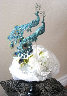 PEACOCK Wedding Cake Toppers -- Gorgeous & Glittery Iridescent Green w/ Mini Peacock Feathers, Curled Herl and Sparkling Swarovski Jewels. $68.00, via Etsy.