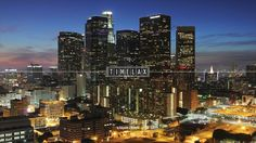Watch a Mesmerizing Hyperlapse Video of a Supermoon Setting Over the LA Skyline  ...