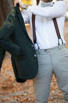 green felt jacket. grey wool pants. bow tie. Bracers.