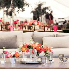 Love this look, bright colors and mercury glass everywhere!! skip those pink chair sashes though...