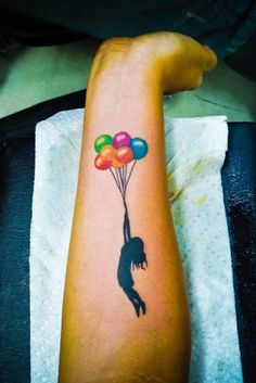 See more Flying high with balloons tattoo on arm