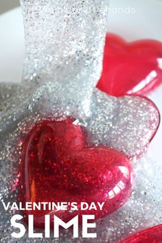 Use our favorite homemade slime recipe and dollar store glitter glue to make this awesome Valentines Day slime. Kids can make slime too! Our easy to make slime is also a great Valentine's Day science activity for chemistry. Hands on learning through cool sensory play.  Make slime at home with a simple recipe for amazing slime this Valentine's Day!