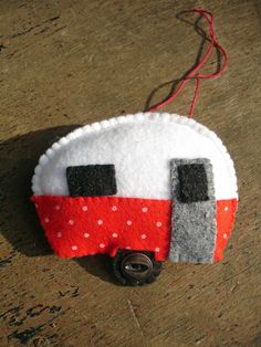 Red and white polka-dotted teardrop trailer Christmas ornament